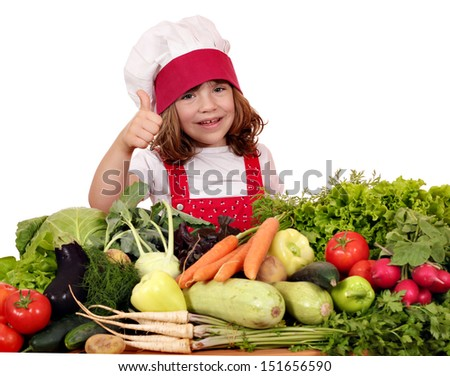 happy little girl cook with thumb up and vegetables - stock photo