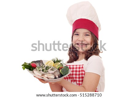 happy little girl cook with trout fish
