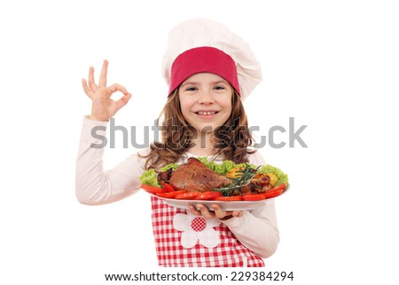 happy little girl cook with turkey drumstick and ok hand sign - stock photo