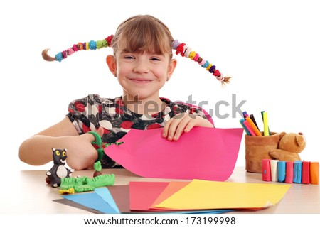 happy little girl cutting paper