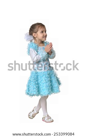 Happy little girl dancing on white - stock photo