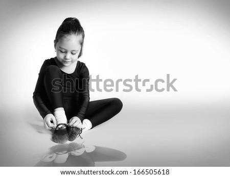 Happy little girl doing gymnastics - stock photo