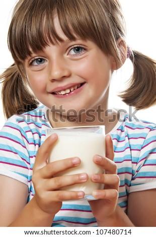happy little girl drinking milk close up - stock photo