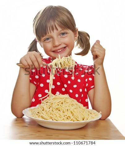 happy little girl eating spaghetti - stock photo