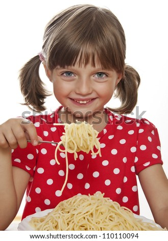 happy little girl eating spaghetti - white background - stock photo