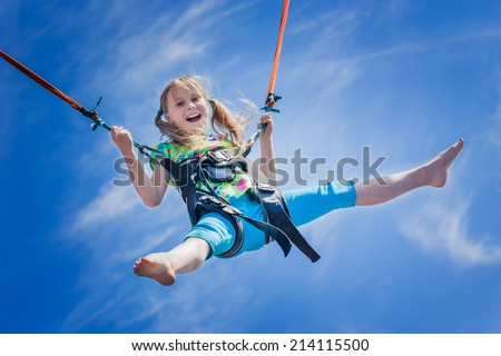 happy little girl flying over the blue sky