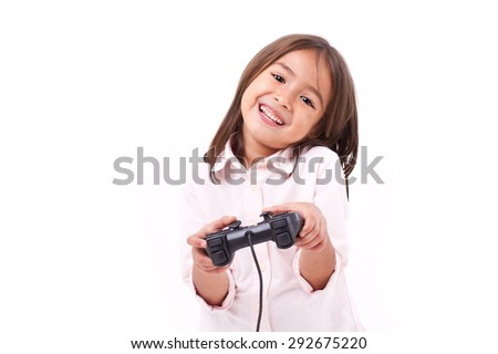 happy little girl gamer playing video game - stock photo