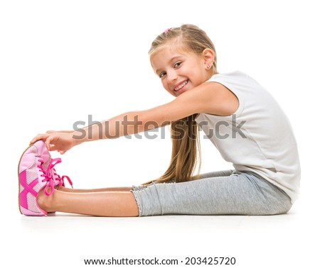 happy little girl goes in for sports. studio shot isolated on white - stock photo