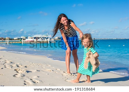 Happy little girl have fun at beach during caribbean vacation