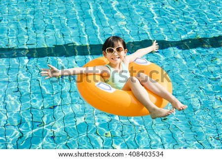 happy little girl having fun  in swimming pool - stock photo