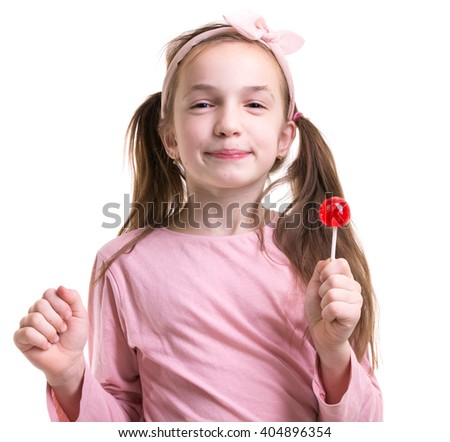 Happy little girl hold pink lollipop - stock photo
