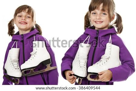 happy little girl holding ice skates on white background - stock photo