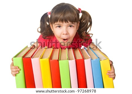 Happy little girl holding pile of books. Isolated over white - stock photo