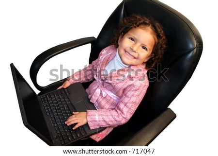 Happy little girl in business suit holding laptop.  Over white. - stock photo