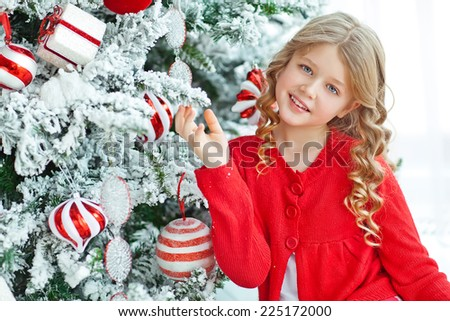 Happy little girl in Christmas at the Christmas tree. Baby New Year holiday - stock photo