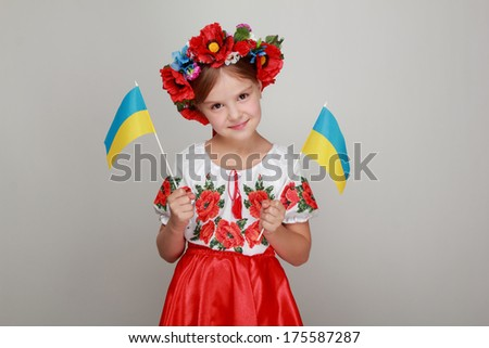 Happy little girl in colorful national costume of Ukraine