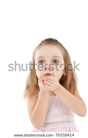 Happy little girl in pink dress throwing a kiss on white background. - stock photo