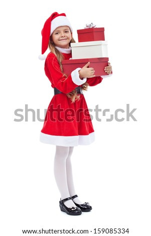 Happy little girl in santa outfit holding presents - isolated - stock photo