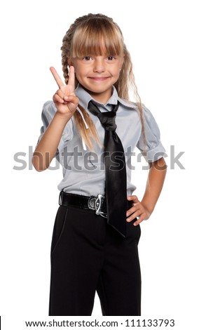 Happy little girl in school uniform isolated on white background
