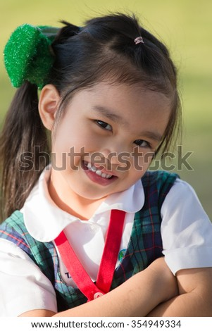 Happy little girl  in school uniformhaving fun at the school