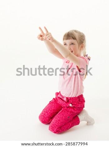 Happy little girl indicating something up, white background - stock photo