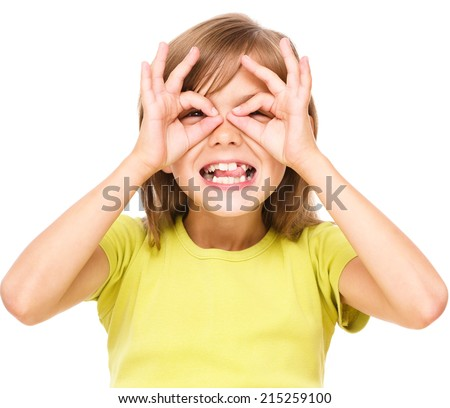 Happy little girl is showing glasses gesture, isolated over white - stock photo