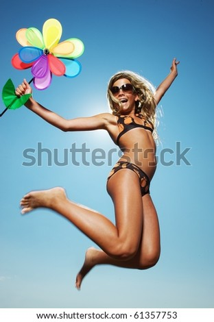 Happy little girl jumping - stock photo