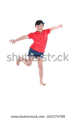 happy little girl jumping in air - stock photo