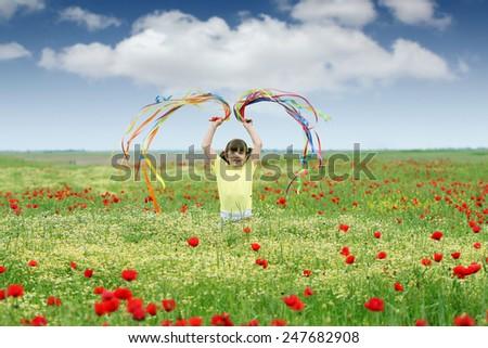 happy little girl on meadow spring season - stock photo