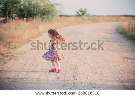 happy little girl on road - stock photo