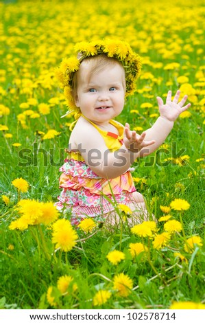 Happy little girl  on the meadow - stock photo