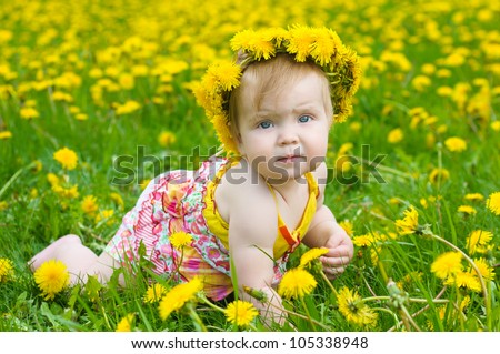 Happy little girl  on the meadow with yellow flowers