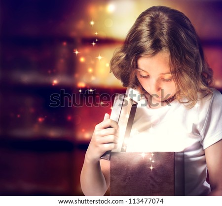 Happy Little Girl Opening a Present Box - stock photo