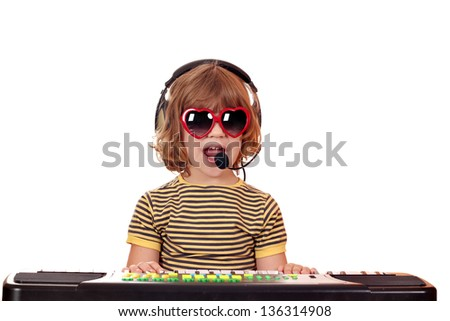 happy little girl play music and sing - stock photo
