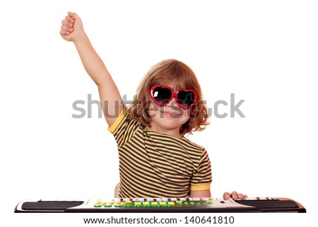 happy little girl play music on keyboard