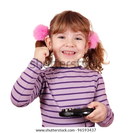 happy little girl play video game and win - stock photo