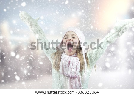 Happy little girl playing with snow.  - stock photo