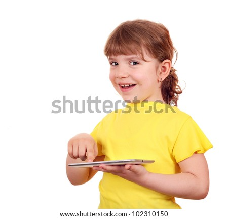 happy little girl playing with tablet pc - stock photo