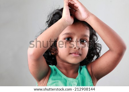 Happy little girl poses and shows actions - stock photo