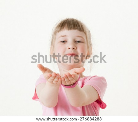 Happy little girl reaching out her palms and catching something, white background