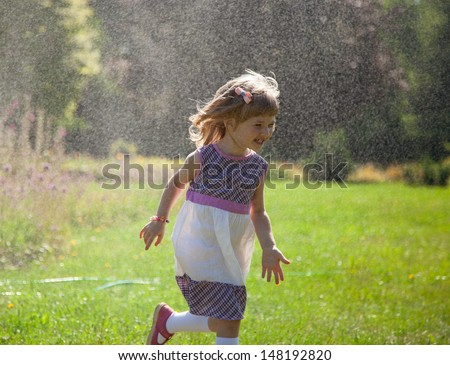 Happy little girl running away from rain