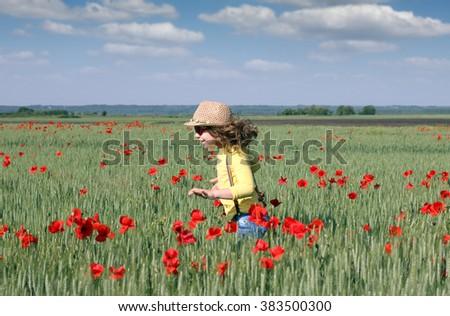 happy little girl running on meadow spring season - stock photo