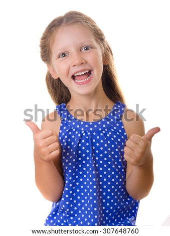Happy little girl showing the thumb isolated on white background - stock photo