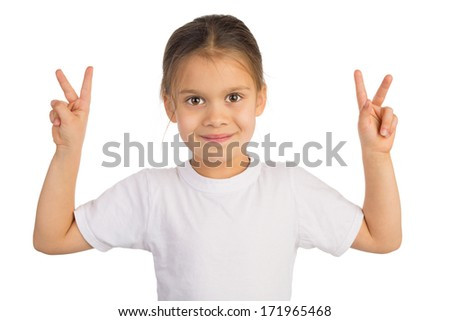 Happy little girl shows Victory sign with both hands. Isolated on white. - stock photo