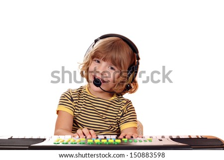 happy little girl sing and play keyboard - stock photo