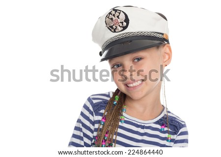 Happy little girl six years old in a suit cabin boy. Girl is six years old. On her cap emblem of Russia. - stock photo