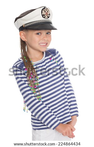 Happy little girl six years old in a suit sailor boy. Girl is six years old. On her cap emblem of Russia. - stock photo