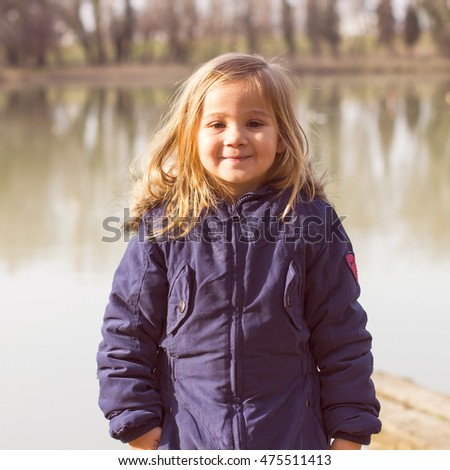 Happy Little Girl , smiling portrait of adorable child. spring time, day light.