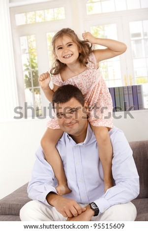 Happy little girl smiling with father.? - stock photo