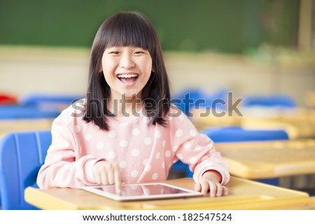 happy little girl using tablet  or ipad - stock photo